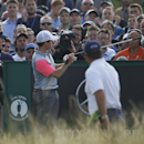 Rory McIlroy of Northern Ireland points to a disturbance in the crowd on the 16th hole during the final round of the British Open Golf championship at the Royal Liverpool golf club, Hoylake, England, Sunday July 20, 2014