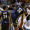 Miami Heat's LeBron James, right, is fouled by Indiana Pacers' Ian Mahinmi (28) during the first half of an NBA basketball game, Friday, April 11, 2014, in Miami The Associated Press