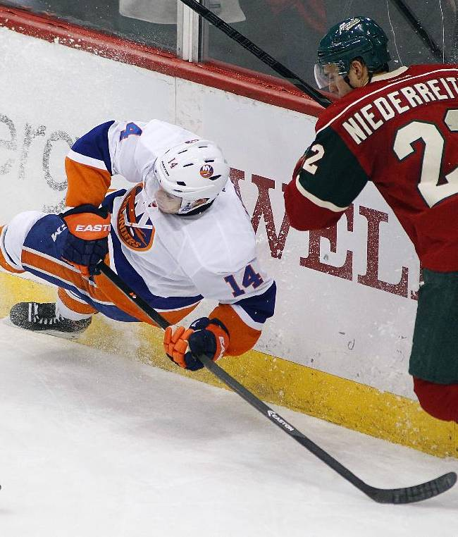 Minnesota Wild forward Nino Niederreiter (22) and New York Islanders defenseman Thomas Hickey (14) collide during the second period of their NHL hockey game, Sunday, Dec. 29, 2013, in St. Paul, Minn