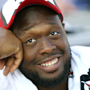 In this Aug. 23, 2014, file photo, Tampa Bay Buccaneers defensive tackle Gerald McCoy (93) watches his team play during the second half of a preseason NFL football game against the Buffalo Bills in Orchard Park, N.Y. McCoy has signed a seven-year extensio