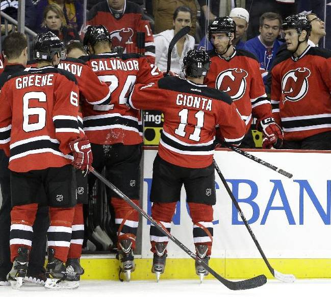 Devils post first win of season, beat Rangers 4-0