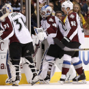Colorado Avalanche's Reto Berra (20), of Switzerland, leaves the ice after being pulled for giving up three goals to the Arizona Coyotes as his replacement Calvin Pickard (31) gets ready and Gabriel Landeskog (92), of Sweden, skates past during the first