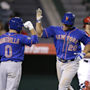 New York Mets' Anthony Recker (20) celebrates his home run with Omar Quintanilla during the 13th inning of a baseball game against the Los Angeles Angels on Saturday, April 12, 2014, in Anaheim, Calif The Associated Press