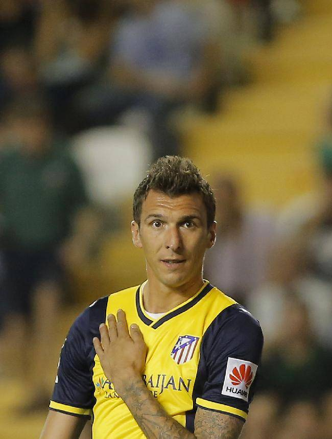 Atletico's Mandzukic gestures during a Spanish La Liga soccer match between Rayo Vallecano and Atletico Madrid at the Vallecas stadium in Madrid, Spain, Monday, Aug. 25, 2014
