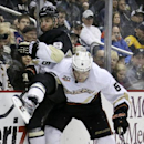 Anaheim Ducks' Ben Lovejoy (6) collides with Pittsburgh Penguins' Pascal Dupuis (9) in the second period of a NHL hockey game in Pittsburgh Monday, Nov. 18, 2013 The Associated Press