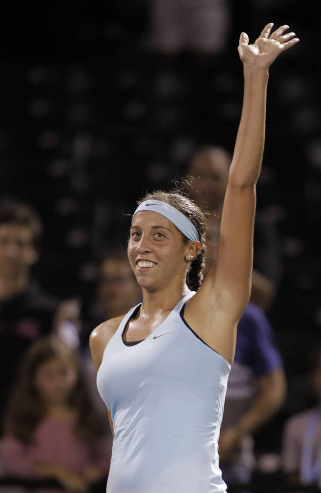 Madison Keys waves after defeating Anett Kontaveit, of Estonia, 6-3, 6-2 during the Sony Open tennis tournament, Wednesday, March 19, 2014, in Key Biscayne, Fla