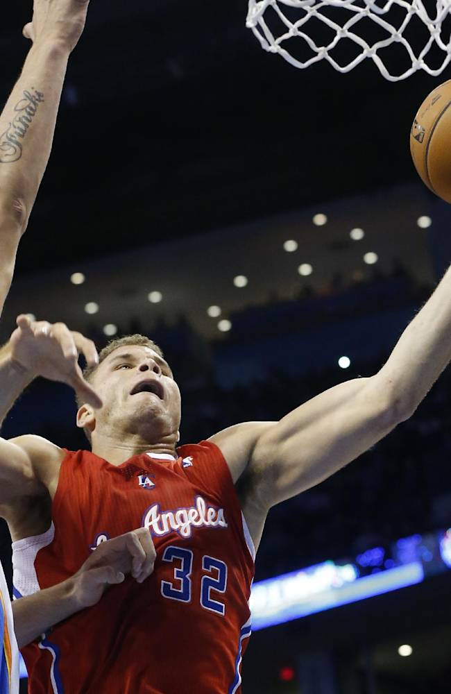 Los Angeles Clippers forward Blake Griffin (32) shoots in front of Oklahoma City Thunder center Steven Adams (12) in the first quarter of an NBA basketball game in Oklahoma City, Thursday, Nov. 21, 2013