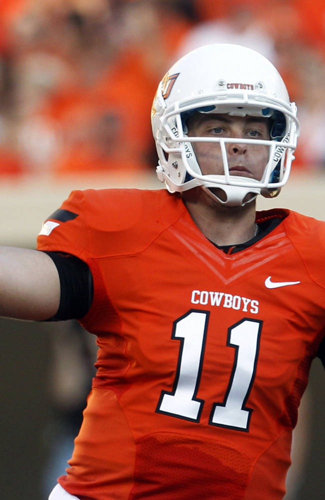 Former Oklahoma St QB Lunt joining Illinois