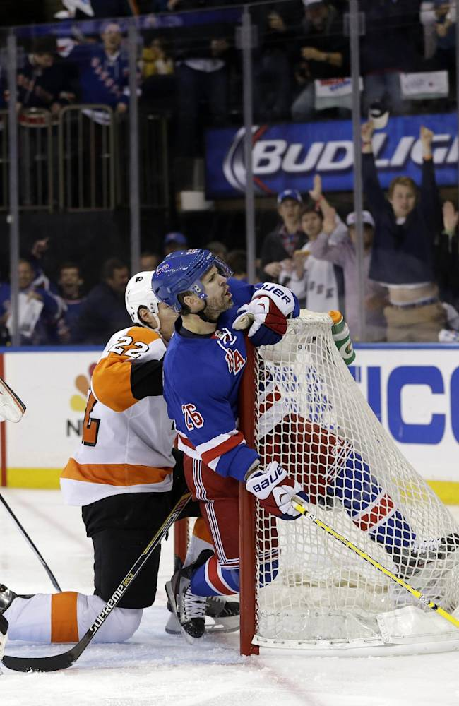 Philadelphia Flyers goalie Steve Mason, left, and New York Rangers' Martin St. Louis, center, looks up at a referee, right, who rules that St. Louis did not score during the second period of Game 5 of an NHL hockey first-round playoff series on Sunday, April 27, 2014, in New York