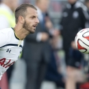 Tottenham Hotspur's Roberto Soldado controls the ball during the first half of a friendly soccer match against Toronto FC in Toronto on Wednesday, July 23, 2014