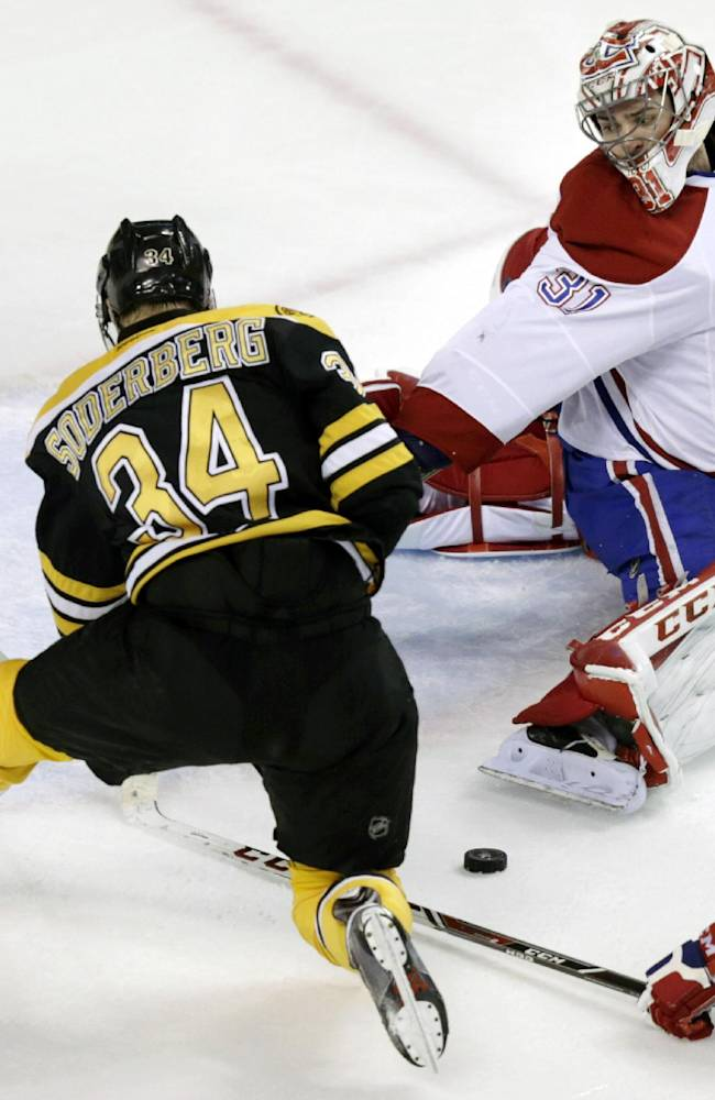 Montreal Canadiens goalie Carey Price (31) reaches back to make a save on a shot by Boston Bruins center Carl Soderberg (34) during the second period of Game 1 in the second-round of a Stanley Cup playoff series in Boston, Thursday, May 1, 2014