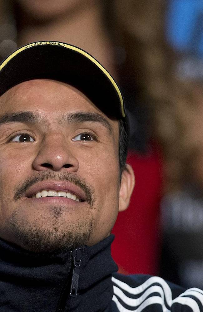 Boxer Juan Manuel Marquez listens to comments during a news conference, Wednesday, Oct. 9, 2013, in Las Vegas.  Marquez is scheduled to fight Timothy Bradley for Bradley's WBO welterweight title on Saturday