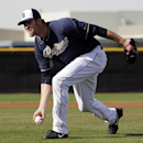 San Diego Padres pitcher Josh Johnson fields a ground ball during spring training baseball practice Sunday, Feb. 16, 2014, in Peoria, Ariz The Associated Press