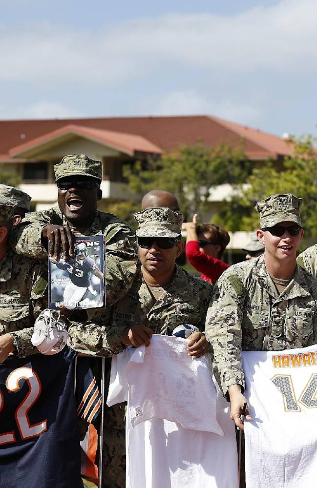 Service members yell for autographs during an NFL Pro Bowl practice on Earhart Field at Joint Base Pearl Harbor-Hickam sponsored by the USAA the official military sponsor of the NFL on Thursday January 23, 2014 in Honolulu, Hawaii. (Aaron M. Sprecher/AP Images for USAA)