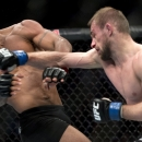 Demetrious Johnson, of the United States, ducks from a punch by Ali Bagautinov, of Russia, during the flyweight bout at UFC 174 in Vancouver, British Columbia, Saturday, June, 14, 2014. (AP Photo/The Canadian Press, Jonathan Hayward)