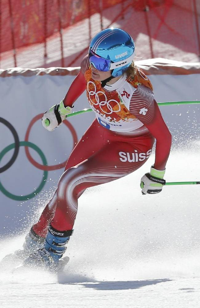 Switzerland's Nadja Jnglin-Kamer comes to a halt at the end of a women's downhill training run for the Sochi 2014 Winter Olympics, Friday, Feb. 7, 2014, in Krasnaya Polyana, Russia
