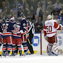 Detroit Red Wings goalie Jonas Gustavsson (50), of Sweden, watches as the New York Rangers celebrate a goal by Rick Nash during the first period of an NHL hockey game Wednesday, Nov. 5, 2014, in New York The Associated Press