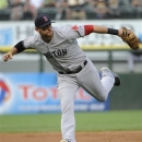 Boston Red Sox third baseman Will Middlebrooks can't make a play on a infield single off the bat of Chicago White Sox's Alexei Ramirez  during the first inning of a baseball game,Tuesday, May 21, 2013, in Chicago.  (AP Photo/David Banks)