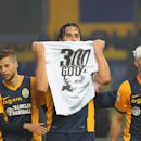 Verona's Luca Toni shows a jersey reading 300, a reference to the number of goals scored in career, after scoring the 1-1 equalizer during the Serie A soccer match between Udinese and Verona at the Friuli Stadium in Udine, Italy, Sunday, Dec. 14, 2014