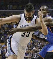 Memphis Grizzlies center Marc Gasol (33) drives against Oklahoma City Thunder forward Serge Ibaka during the first half of Game 3 of an opening-round NBA basketball playoff series Thursday, April 24, 2014, in Memphis, Tenn. (AP Photo/Mark Humphrey)
