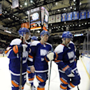 New York Islanders' Thomas Hickey (14), Casey Cizikas (53) and Cal Clutterbuck (15) leave the ice after losing to the New Jersey Devils 6-1 in an NHL hockey game on Saturday, March 1, 2014, in Uniondale, N.Y The Associated Press