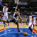 Oklahoma City Thunder guard Thabo Sefolosha (25) loses the ball driving on Detroit Pistons guard Chauncey Billups (1), Greg Monroe (10) and Andre Drummond (0) in the first half of an NBA basketball game in Detroit, Friday, Nov. 8, 2013 The Associated Pres