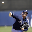 Tampa Bay Rays relief pitcher Mark Lowe warms up in the second inning of a exhibition baseball game against the Pittsburgh Pirates in Port Charlotte, Fla., Saturday, March 8, 2014 The Associated Press