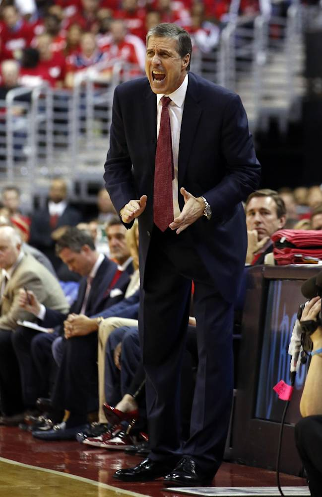 Washington Wizards head coach Randy Wittman directs his team in the second half of Game 3 of an opening-round NBA basketball playoff series against the Chicago Bulls, Friday, April 25, 2014, in Washington. The Bulls won 100-97