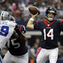 Dallas Cowboys defensive end George Selvie (99) rushes as Houston Texans quarterback Ryan Fitzpatrick (14) passes under pressure during the first half of an NFL football game, Sunday, Oct. 5, 2014, in Arlington, Texas The Associated Press