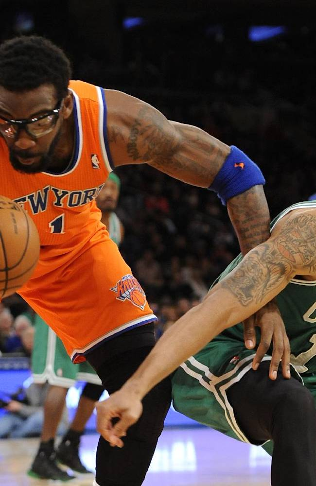 Boston Celtics' Courtney Lee (11) knocks the ball loose from New York Knicks' Amar'e Stoudemire (1) during the first half of an NBA basketball game on Sunday, Dec. 8, 2013, in New York. The Celtics won 114-73