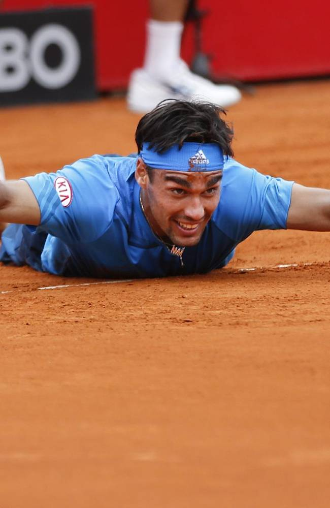 Fabio Fognini of Italy pretends he is swimming after falling to the ground chasing a ball, during the final match of the Buenos Aires' Copa Claro tennis Open against David Ferrer of Spain in Buenos Aires, Argentina,  Sunday, Feb. 16, 2014