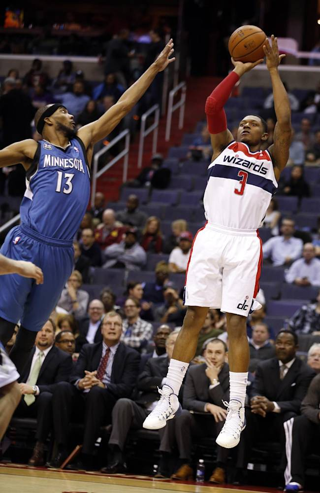 Washington Wizards guard Bradley Beal (3) shoots over Minnesota Timberwolves forward Corey Brewer (13) in the second half of an NBA basketball game Tuesday, Nov. 19, 2013, in Washington. Beal had 25 points and the Wizards won 104-100