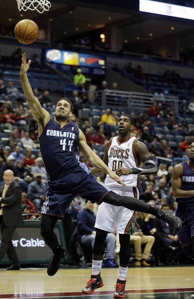 Charlotte Bobcats' Jeff Taylor (44) shoots past Milwaukee Bucks' O.J. Mayo during the first half of an NBA basketball game on Saturday, Nov. 23, 2013, in Milwaukee