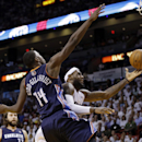Miami Heat's LeBron James, right, goes up for a shot against Charlotte Bobcats' Michael Kidd-Gilchrist (14) during the first half in Game 2 of an opening-round NBA basketball playoff series, Wednesday, April 23, 2014, in Miami. James was called for a foul