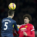 Manchester United's Marouane Fellaini, is beaten to the ball by Southampton's Florin Gardos during the English Premier League soccer match between Manchester United and Southampton at Old Trafford Stadium, Manchester, England, Sunday Jan. 11, 2015