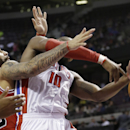Chicago Bulls forward Carlos Boozer (5) knocks the ball away from Detroit Pistons forward Greg Monroe (10) during the second half of an NBA basketball game in Auburn Hills, Mich., Wednesday, March 5, 2014 The Associated Press