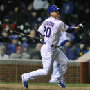 In this April 22, 2014, file photo Chicago Cubs' Justin Ruggiano watches his 2 RBI single during the eighth inning of a baseball game against the Arizona Diamondbacks in Chicago. The Mariners have found a right-handed bat for their outfield, acquiring Rug