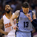 Memphis Grizzlies' Mike Miller (13) smiles after hitting a three-pointer as Phoenix Suns' Markeiff Morris looks away during the second half of an NBA basketball game, Monday, April 14, 2014, in Phoenix. The Grizzlies won 97-91 The Associated Press