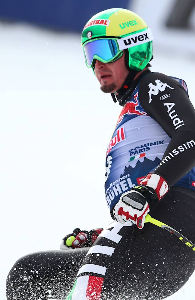 Italy's Dominik Paris gets to the finish area after completing an alpine ski men's World Cup downhill training in Kitzbuehel, Austria, Thursday, Jan. 23, 2014