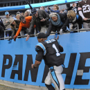 Carolina Panthers' Cam Newton (1) gives high-fives to fans after an NFL football game against the Cleveland Browns in Charlotte, N.C., Sunday, Dec. 21, 2014. The Panthers won 17-13. (AP Photo/Mike McCarn)