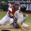 Detroit Tigers&#039; Andy Dirks (12) is tagged out at home plate by Texas Rangers catcher Geovany Soto (8) during the third inning of a baseball game, Friday, May 17, 2013, in Arlington, Texas. (AP Photo/LM Otero)