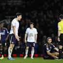 Everton's Gareth Barry, second left reacts to referee Neil Swarbrick's decision to his challenge on West Ham United's Andy Carroll during their English FA Cup third round replay soccer match between West Ham United and Everton at the Boleyn Ground stadium