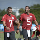 Jacksonville Jaguars quarterbacks Chad Henne (7) and Blake Bortles (5) share a laugh during NFL football training camp in Jacksonville, Fla., Friday, July 25, 2014 The Associated Press