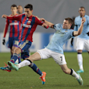 Manchester City's James Milner, right, challenges CSKA's Georgi Milanov during the Champions League Group E soccer match between CSKA Moscow and Manchester City at Arena Khimki stadium in Moscow, Russia, Tuesday Oct. 21, 2014