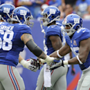 New York Giants tight end Daniel Fells (85) celebrates with tackle Adam Snyder (68) after scoring a touchdown against the Houston Texans in the fourth quarter of an NFL football game, Sunday, Sept. 21, 2014, in East Rutherford, N.J The Associated Press