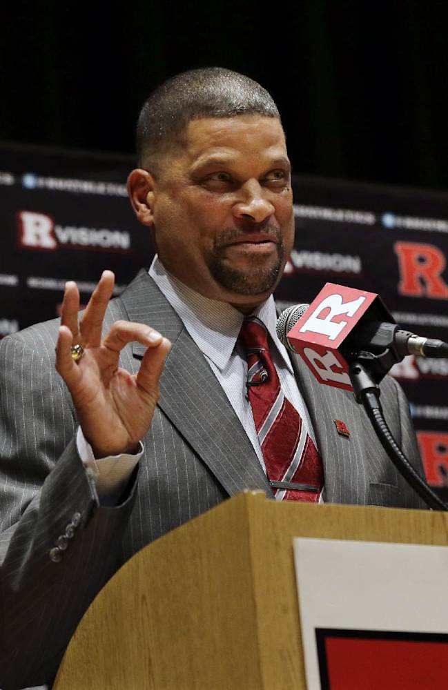 In this April 23, 2013, file photo, Rutgers head coach Eddie Jordan gestures while speaking during an NCAA college basketball news conference in New Brunswick, N.J. Rutgers is trying to forget about its recent dark past by reaching into its long-ago storied past. After a turbulent spring in which Mike Rice was fired for berating players and athletic director Tim Pernetti was forced to resign, the Scarlet Knights brought in Eddie Jordan as their 18th head coach