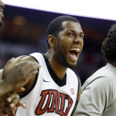 UNLV's Mike Moser reacts to a shot in the final moments of the second half of an NCAA college basketball game against Colorado State on Wednesday, Feb. 20, 2013, in Las Vegas. UNLV defeated Colorado State 61-59. (AP Photo/Isaac Brekken)