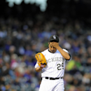 Colorado Rockies starting pitcher Jorge De La Rosa wipes his brow after giving up a run in the first inning of a baseball game against the Arizona Diamondbacks on Saturday, April 5, 2014, in Denver The Associated Press