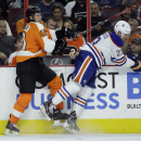 Philadelphia Flyers' Vincent Lecavalier (40) collides with Edmonton Oilers' Matt Hendricks (23) during the first period of an NHL hockey game, Tuesday, Nov. 4, 2014, in Philadelphia The Associated Press
