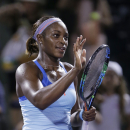 Sloane Stephens, of the United States, celebrates after defeating Yanina Wickmayer, of Belgium, 6-1, 6-3, at the Miami Open tennis tournament, Wednesday, March 25, 2015, in Key Biscayne, Fla. (AP Photo/Wilfredo Lee)